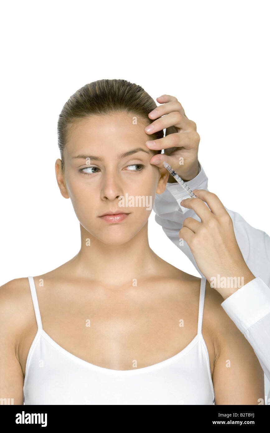 Young woman receiving Botox injection - Stock Image