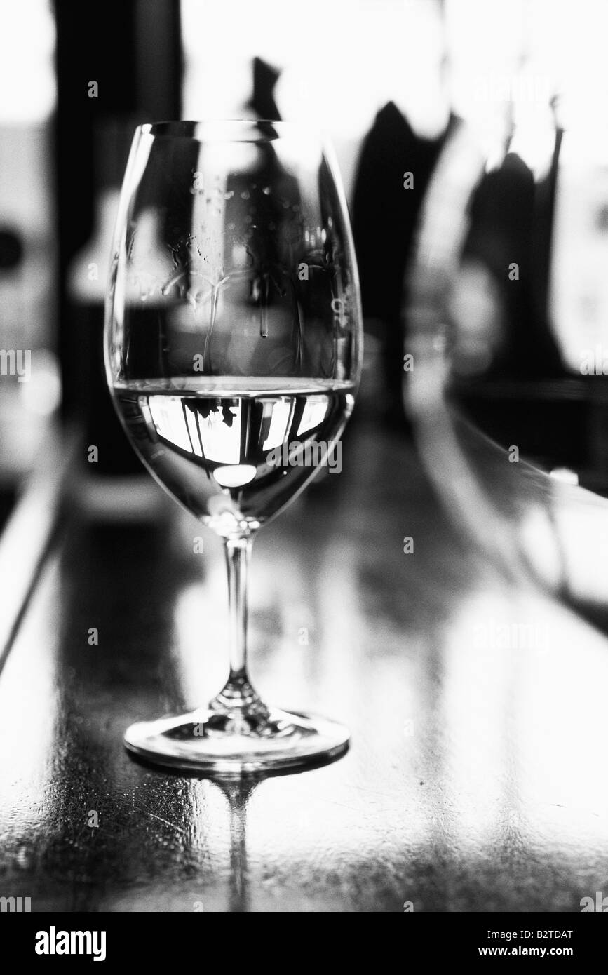 Wine glass on bar counter - Stock Image
