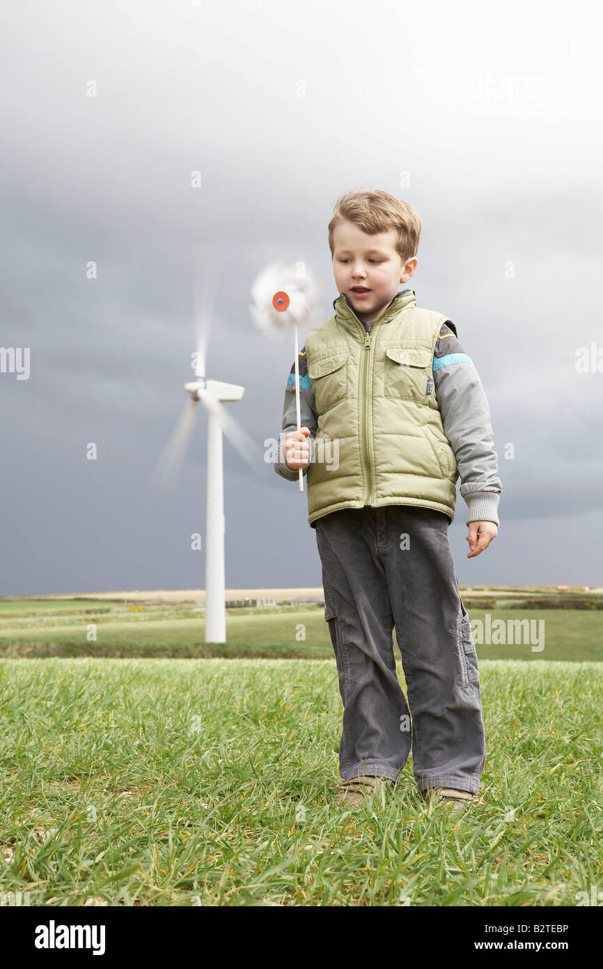 Boy with windmill on a wind farm - Stock Image