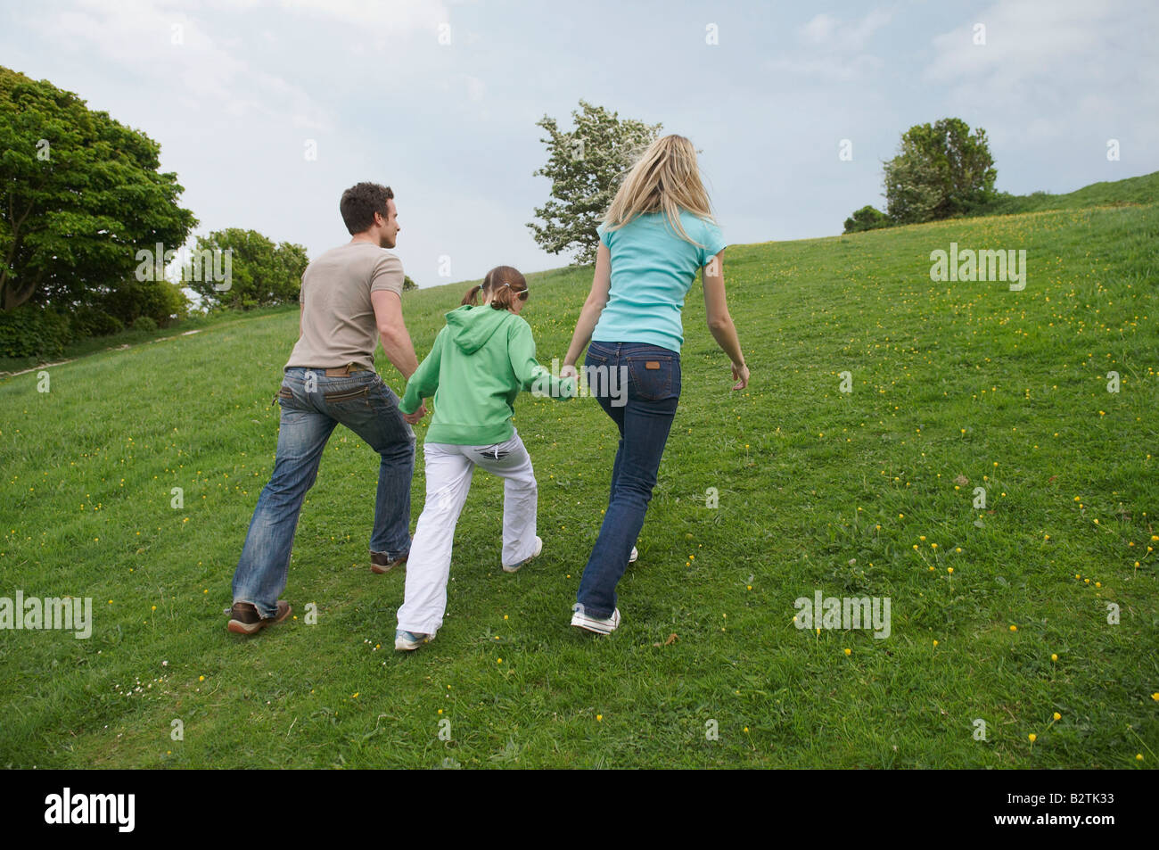 Family walk up hill - Stock Image