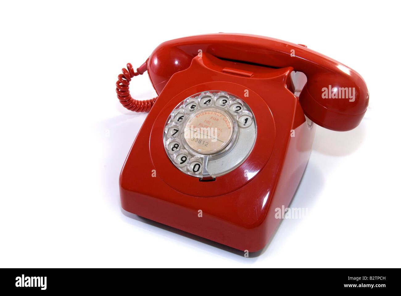 A Red retro telephone in isolation - Stock Image