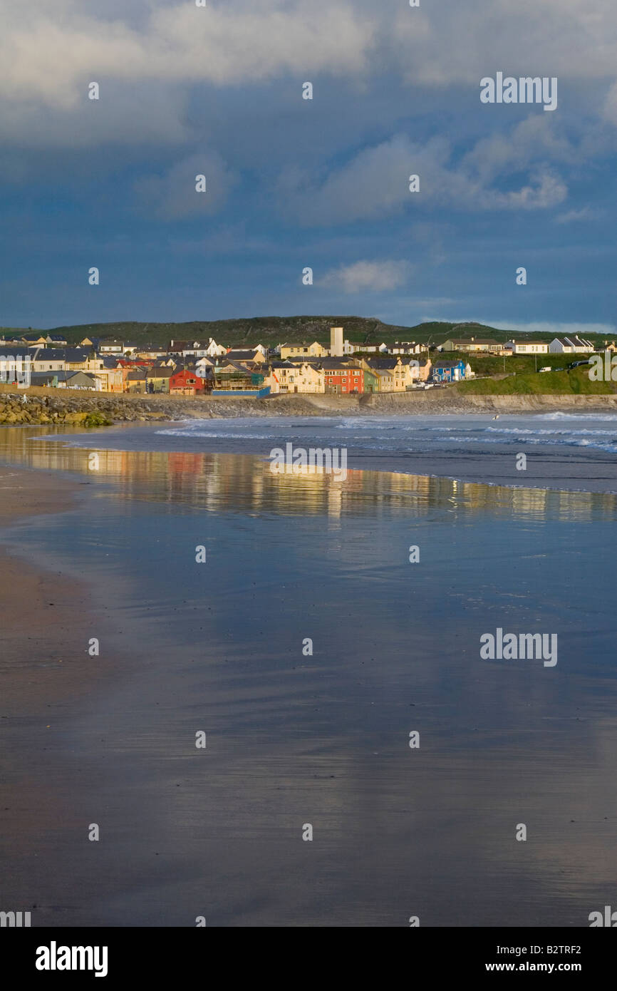 The seaside golfing and surf town of Lahinch Co Clare Ireland reflection in the water at sunset - Stock Image
