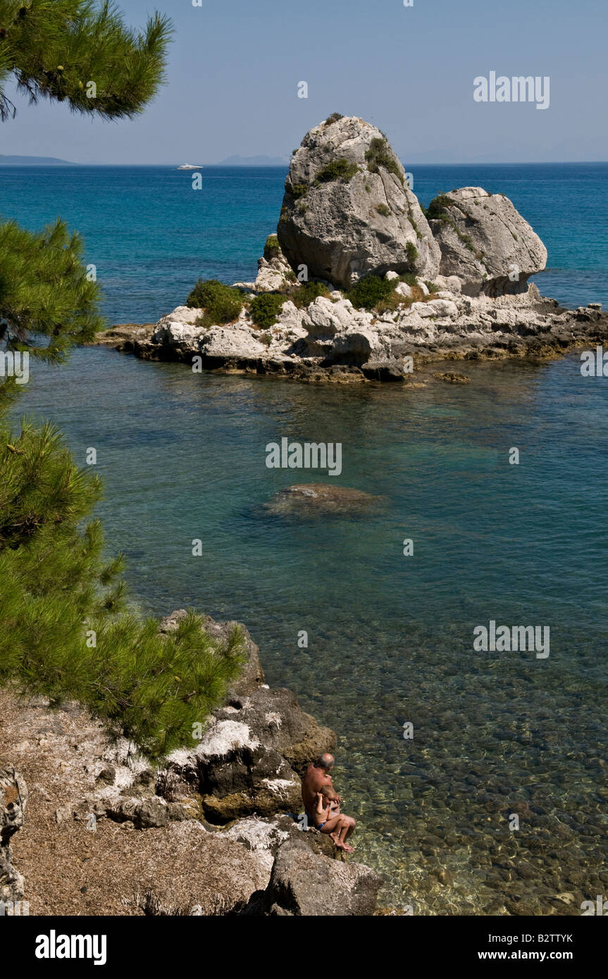 Swimming of the rocks at Poros on Kefalonia s South eastern coast Ionian islands Greece - Stock Image