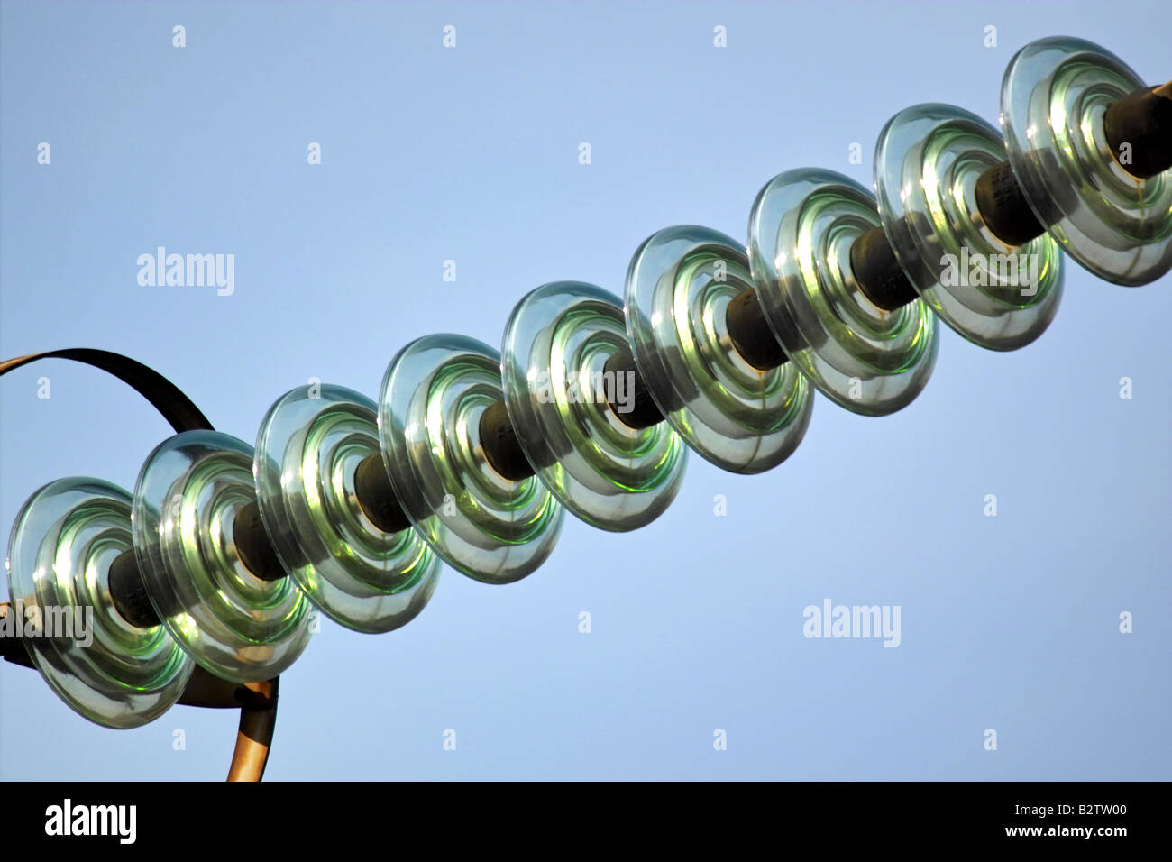Glass high voltage insulator - Stock Image