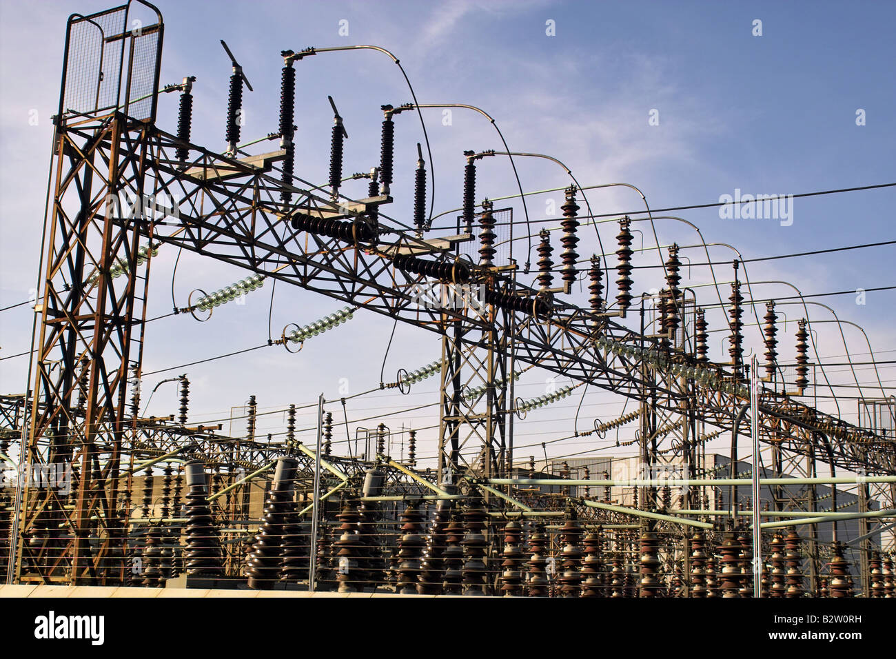high tension electrical cabling, with insulators - Stock Image