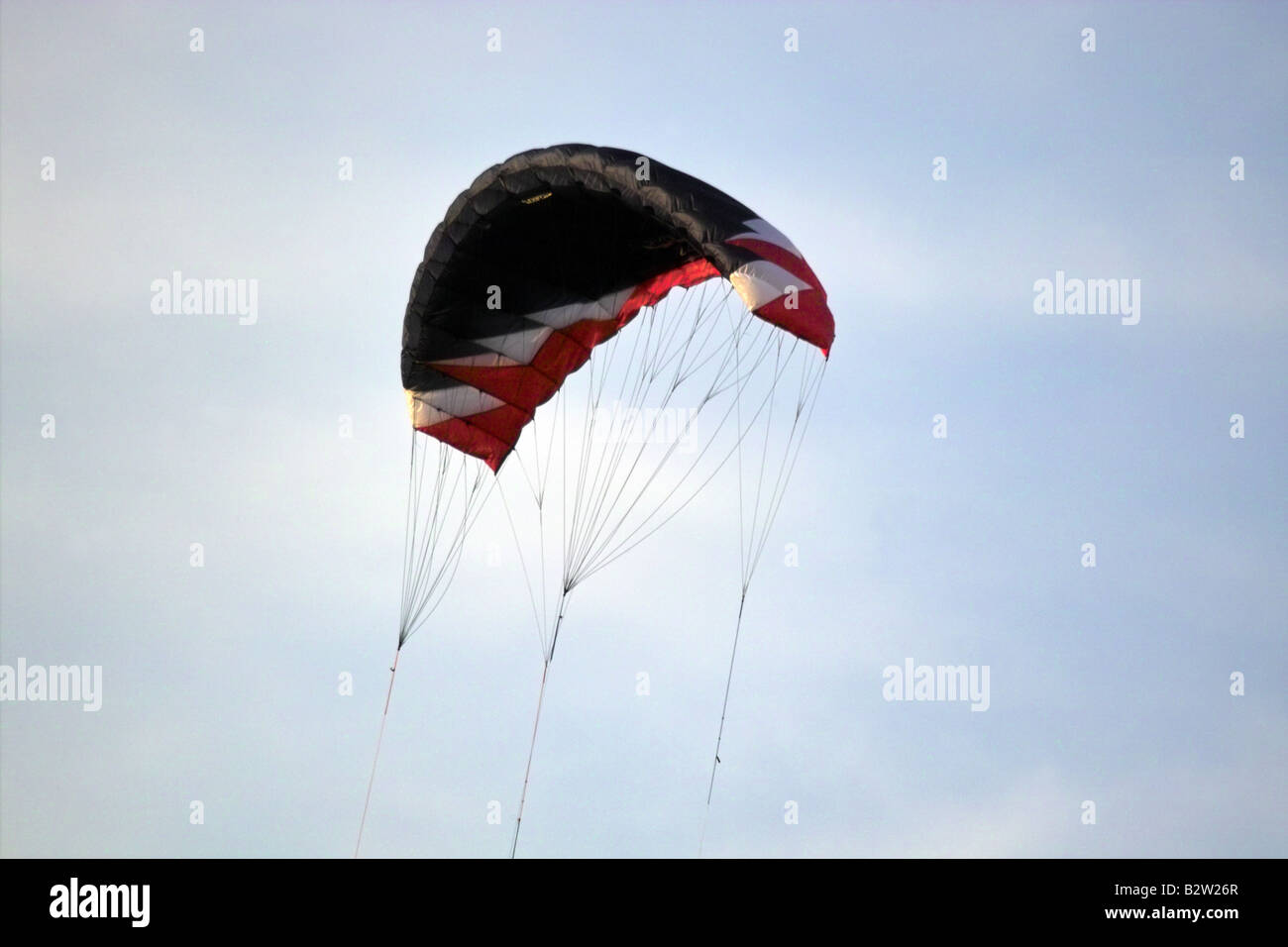 Black white and red flying kite - Stock Image