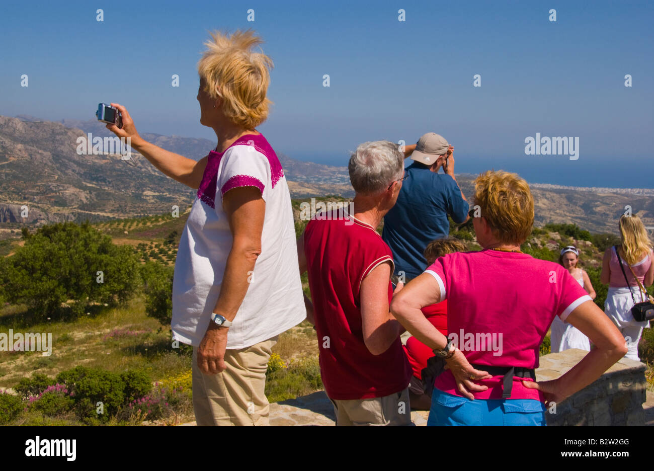 Tourists take photographs at mountain viewpoint near village of Kalamafka on the Greek Mediterranean island of Crete Stock Photo