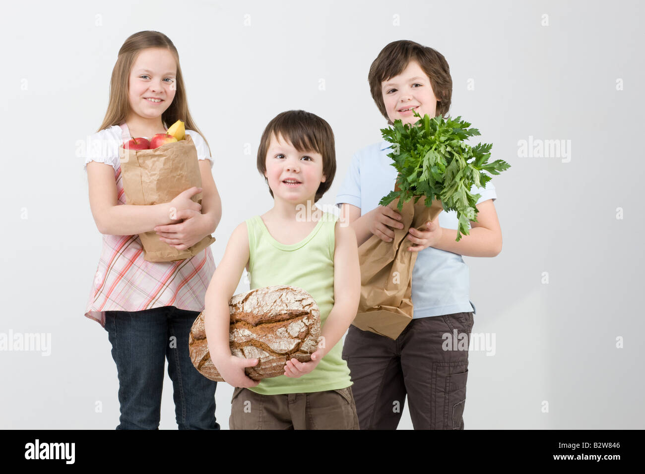 Children with groceries - Stock Image