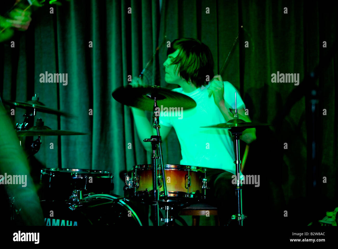 drummer performing with a rock band - Stock Image