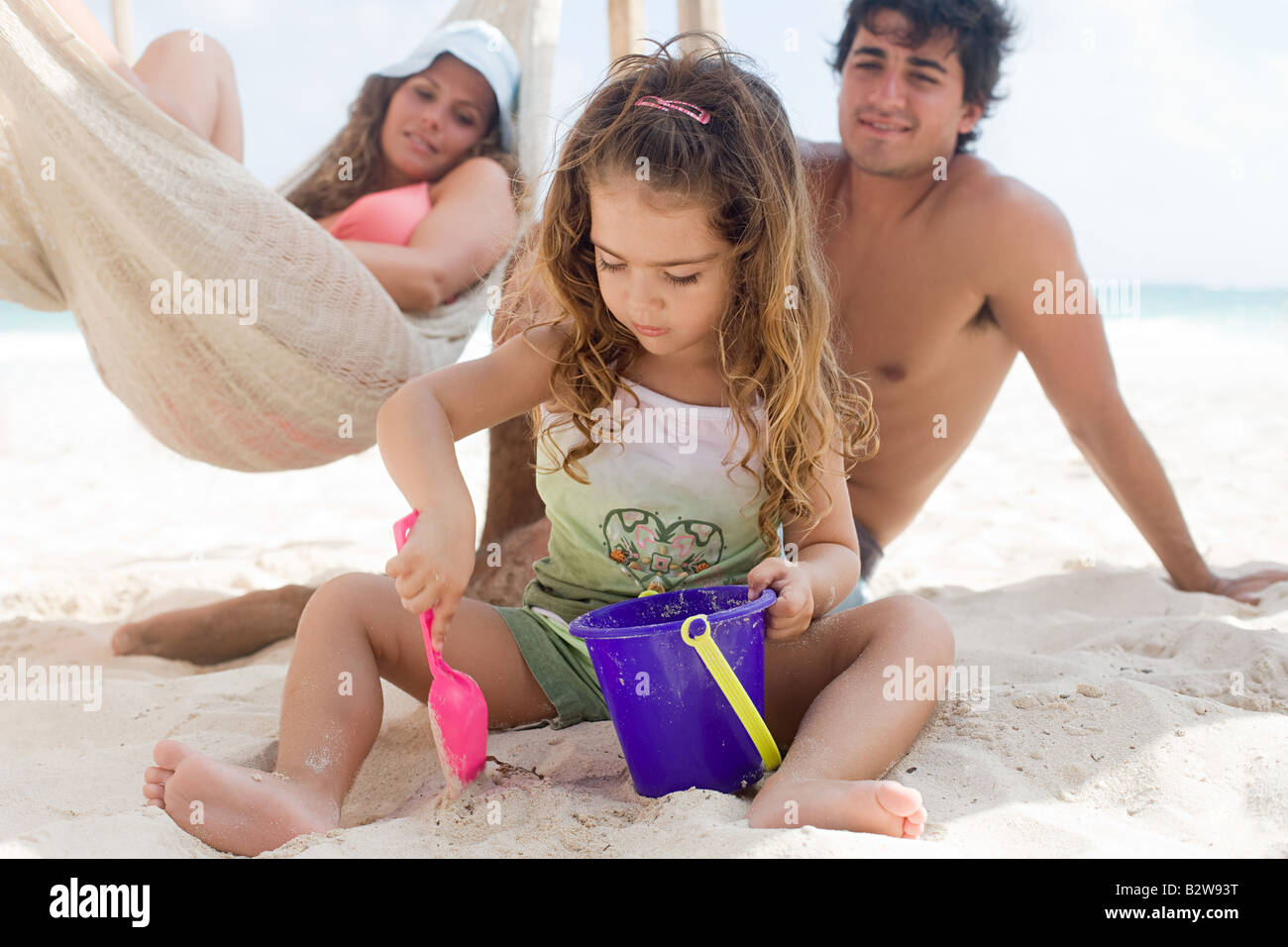 Parents watching their daughter - Stock Image