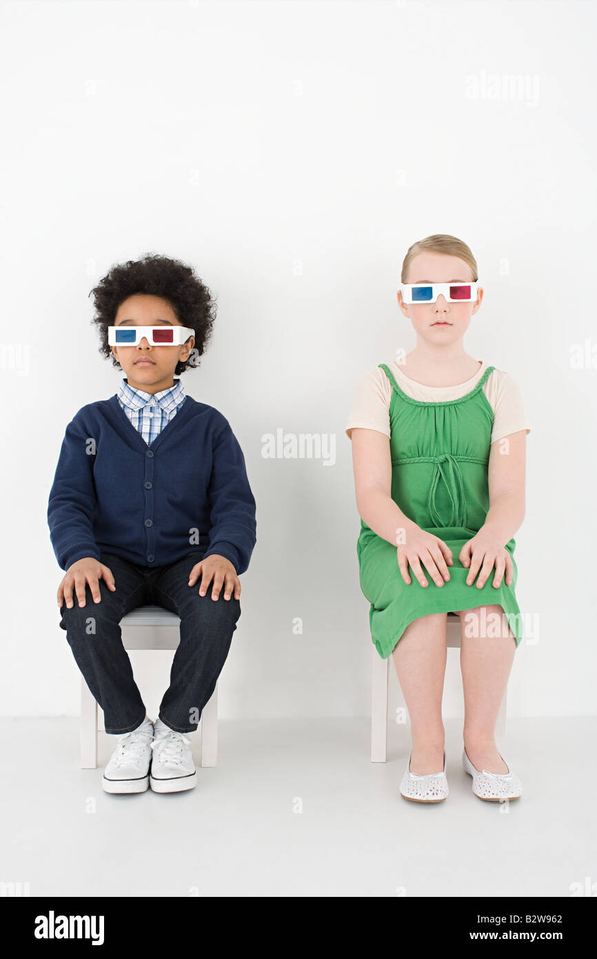 Boy and girl in 3D glasses - Stock Image