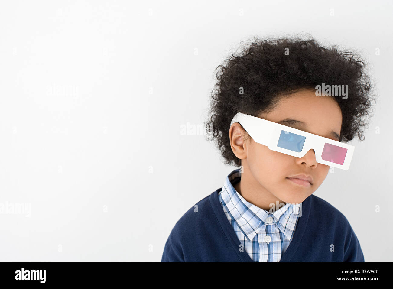 Boy wearing 3D glasses - Stock Image