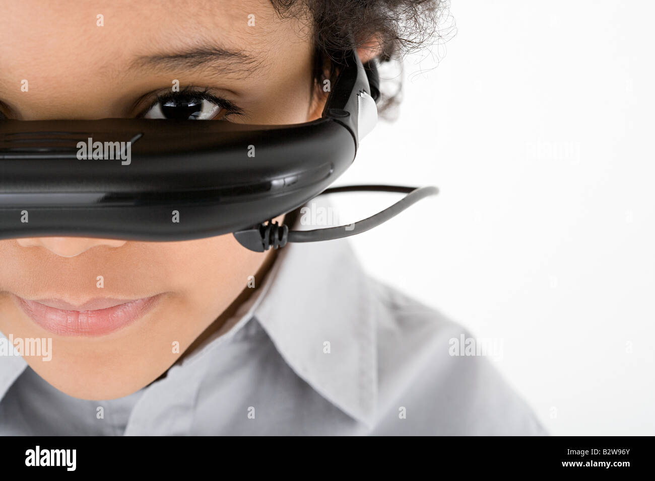 Boy wearing virtual reality headset - Stock Image