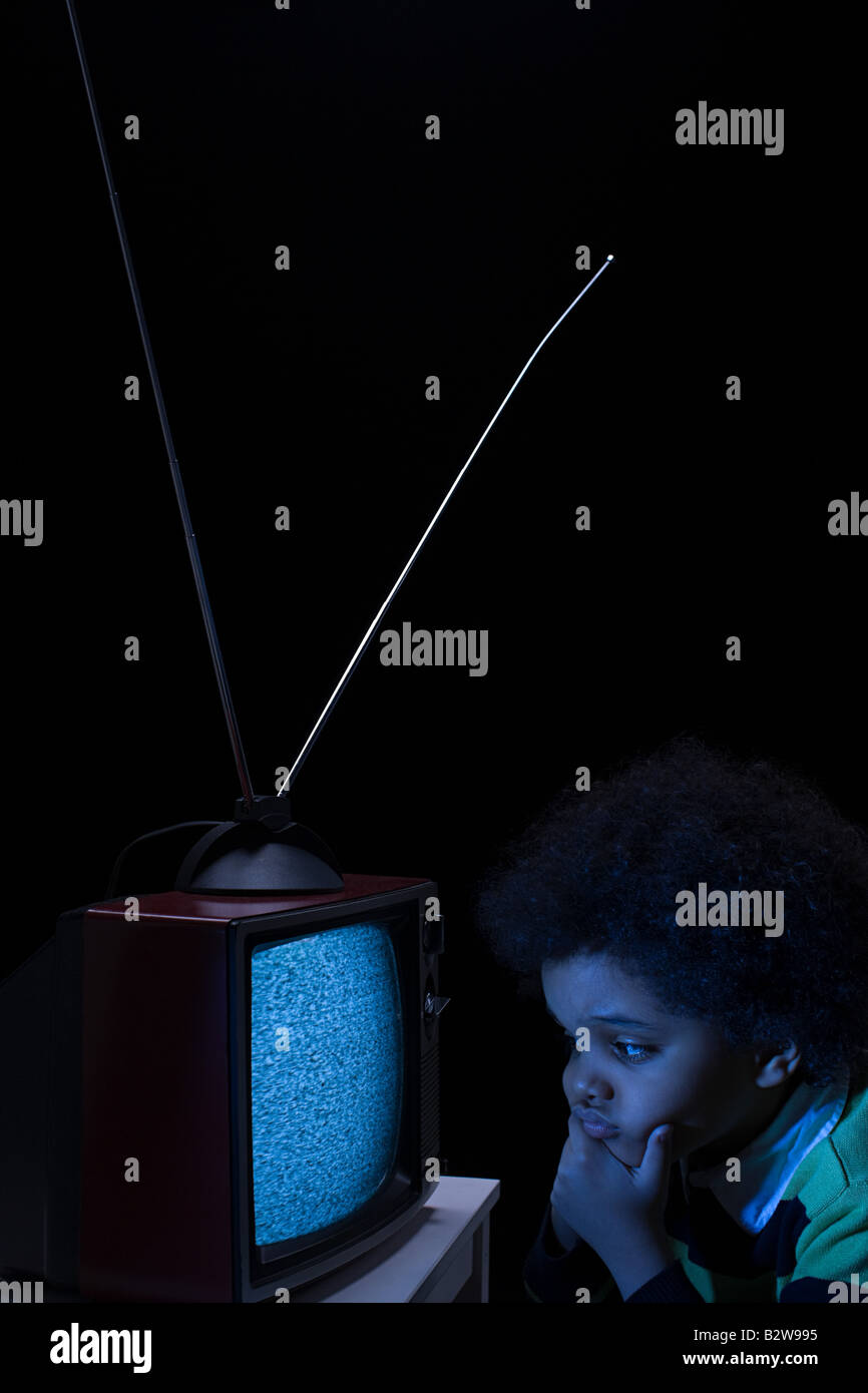 Boy looking at tv screen - Stock Image