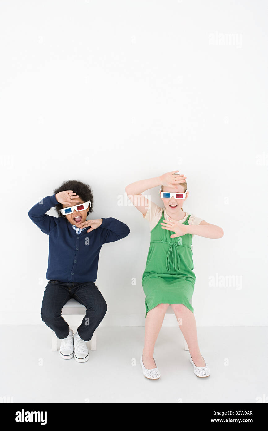 Boy and girl in 3D glasses Stock Photo