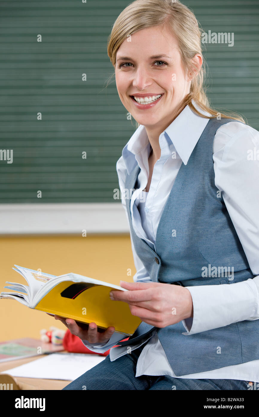 Teacher with textbook - Stock Image