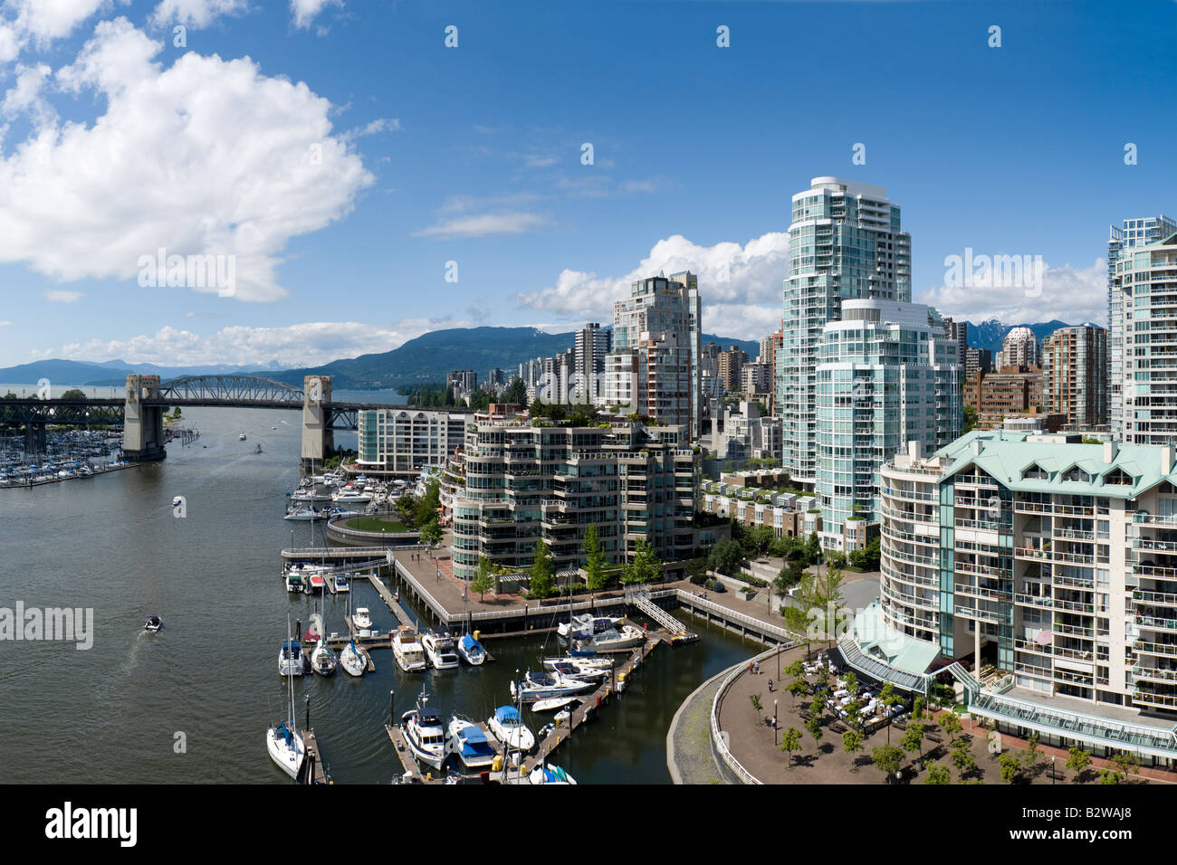The north side of False Creek and Burrard Bridge as seen from Granville Bridge in Vancouver, BC, Canada. - Stock Image