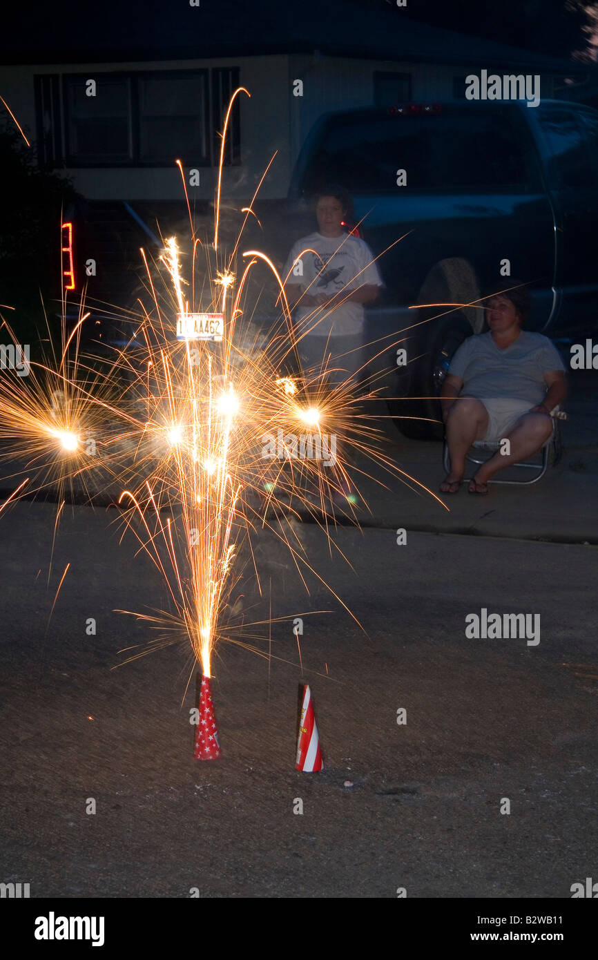 Consumer fireworks lit for Fourth of July neighborhood celebration in Boise Idaho Stock Photo