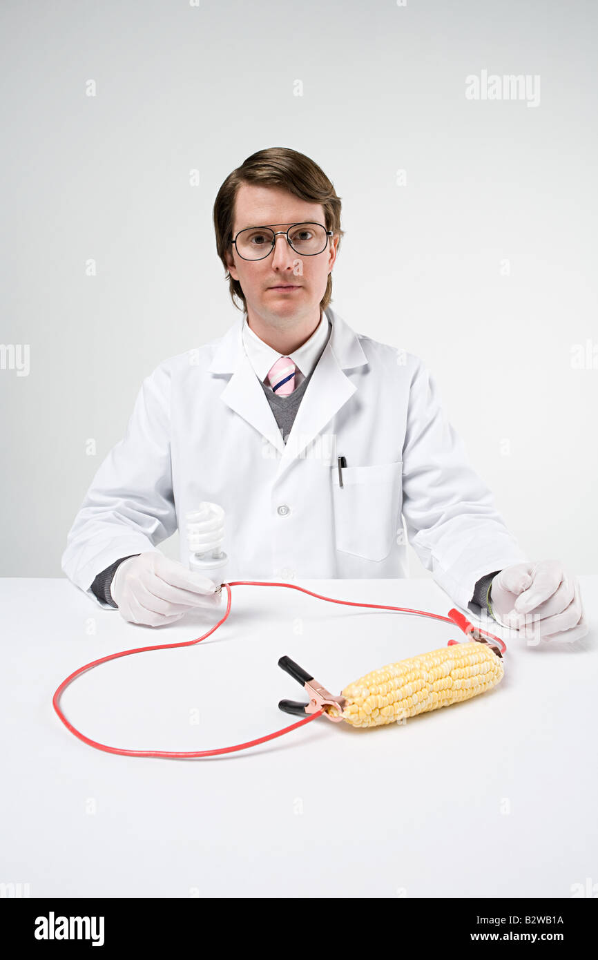 Scientist with sweetcorn and lightbulb Stock Photo