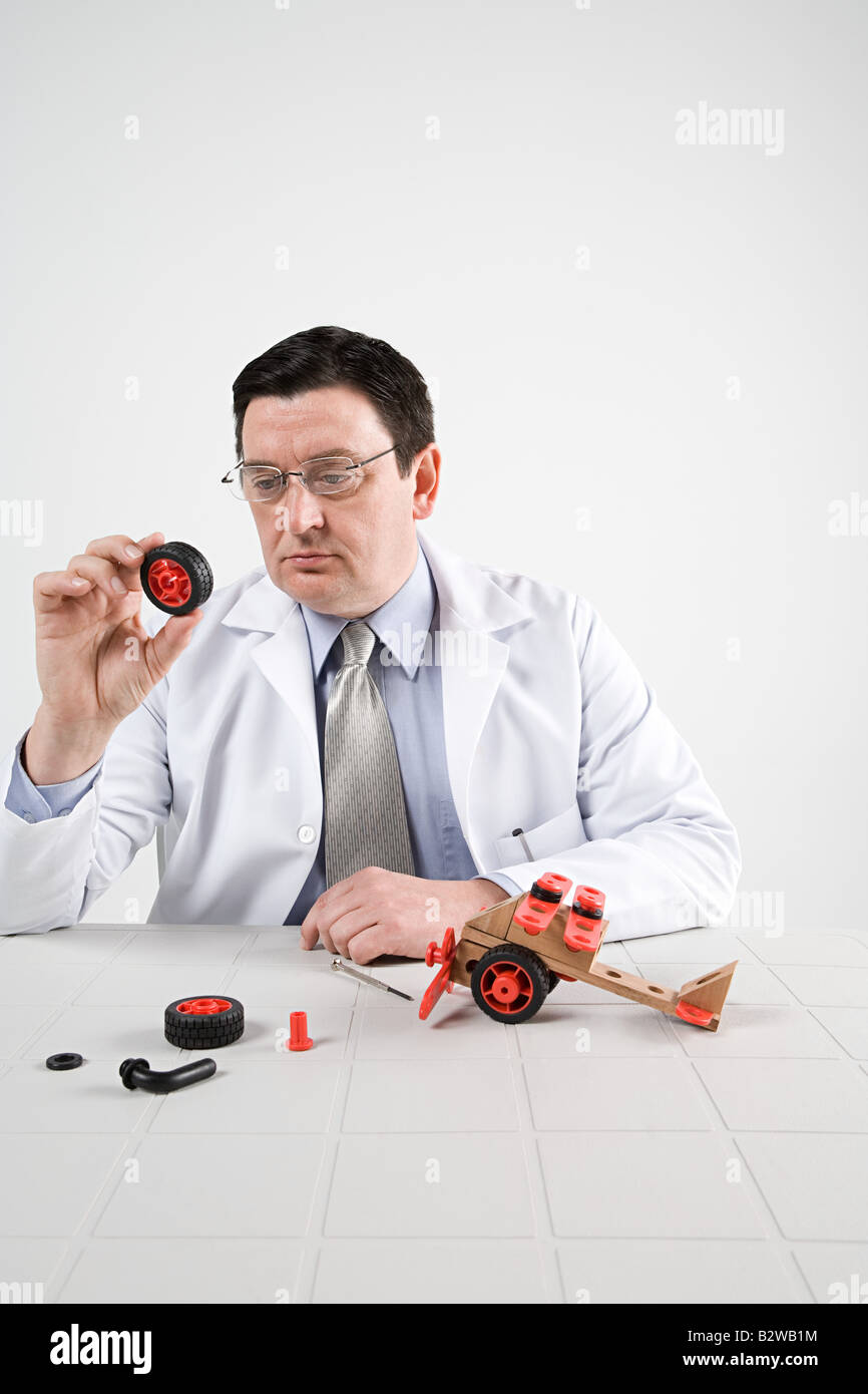 Scientist with model helicopter - Stock Image