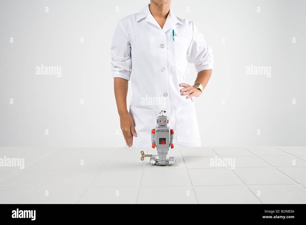Scientist and robot Stock Photo