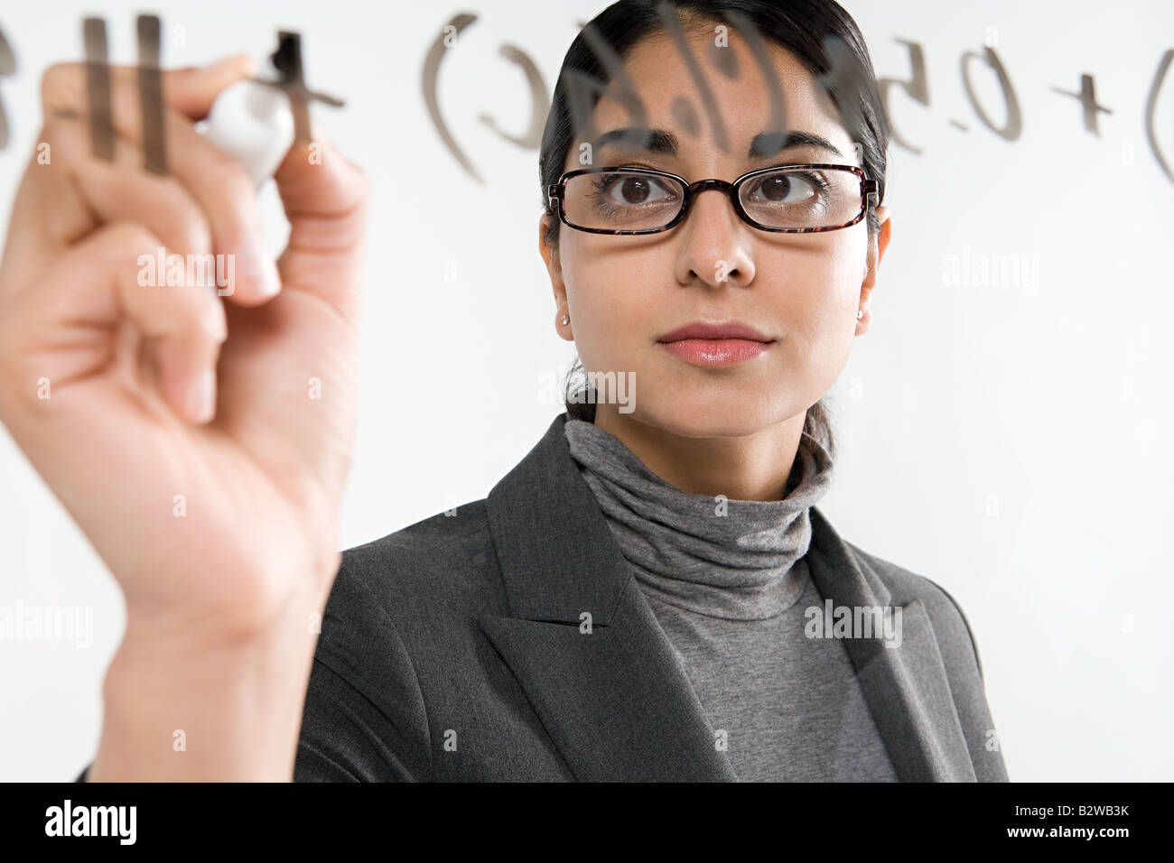 Scientist writing formula Stock Photo