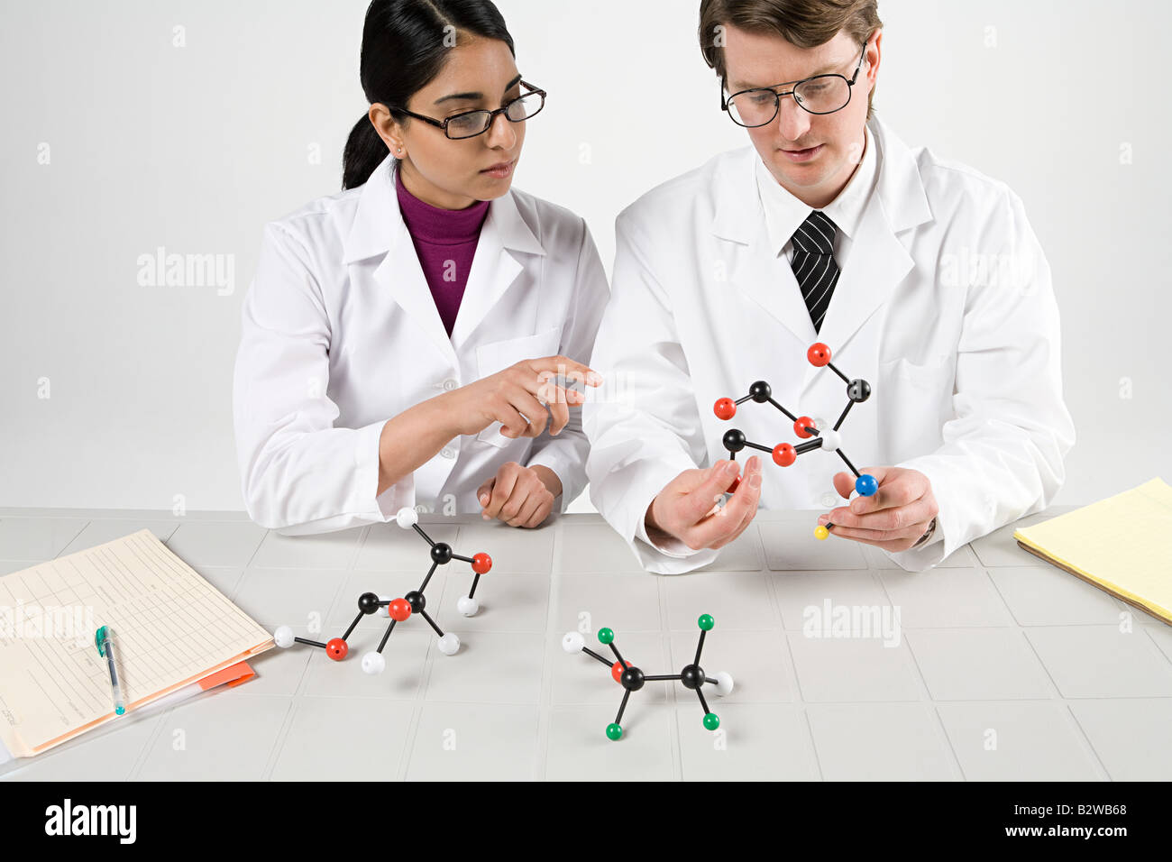 Scientists with molecule models Stock Photo