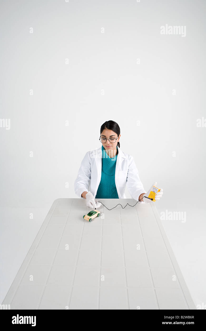 Scientist with model car Stock Photo