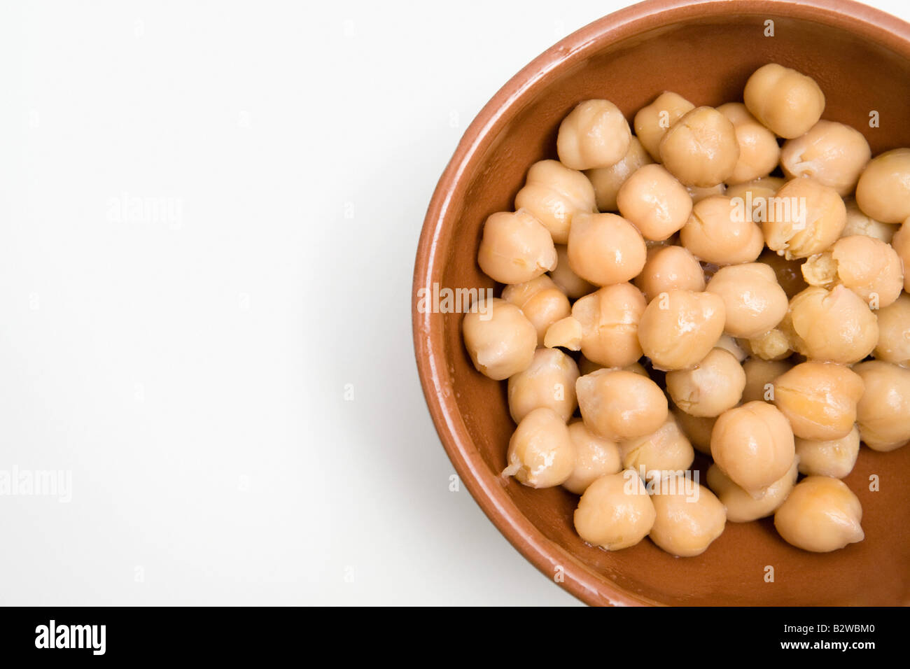 Chick peas in a dish - Stock Image