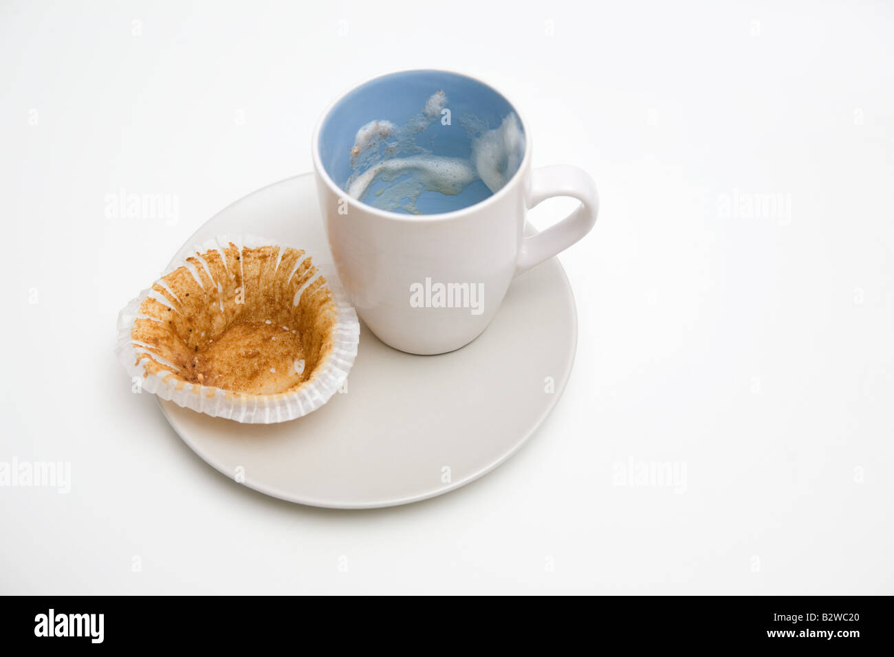 Empty coffee cup and wrapper - Stock Image