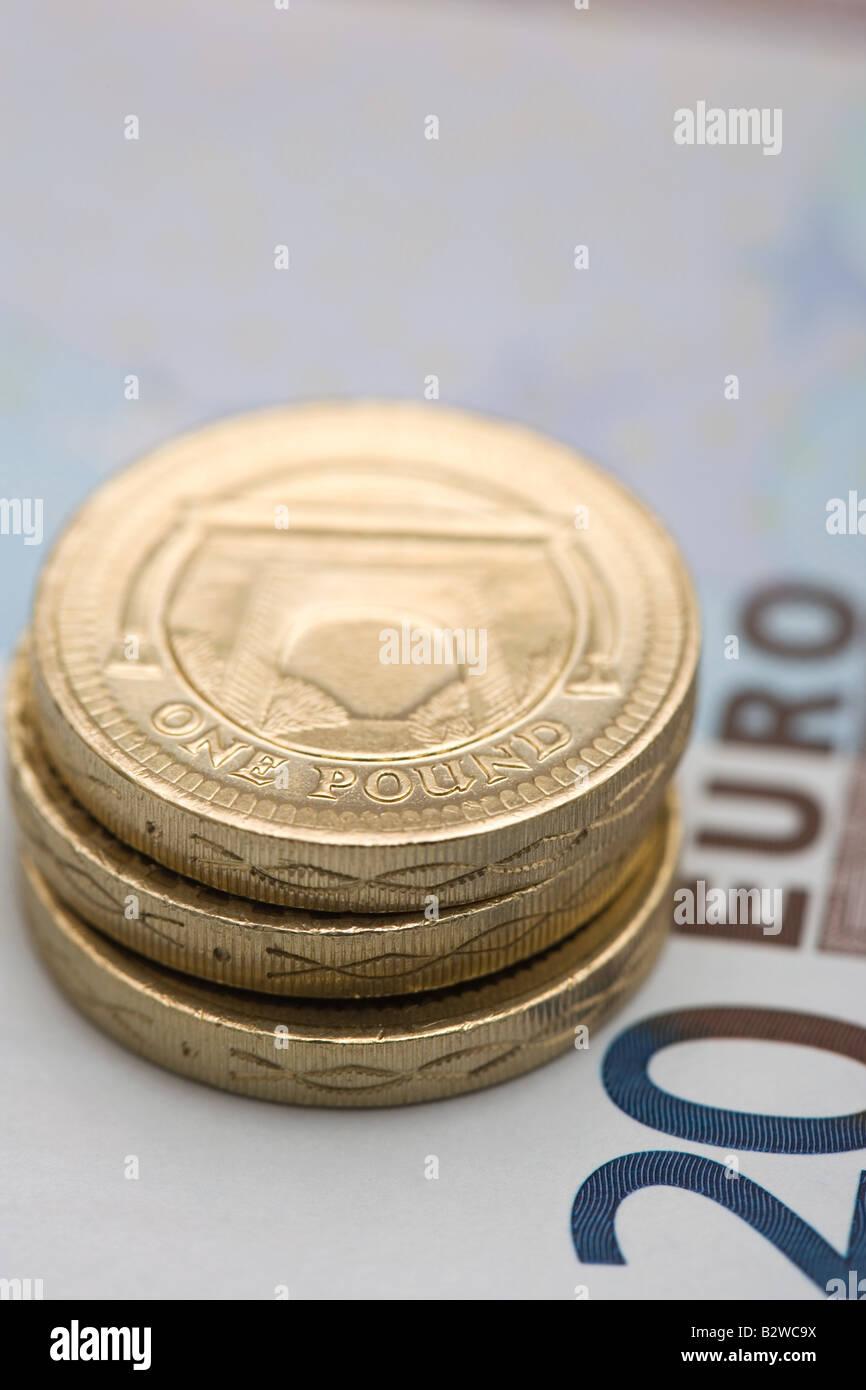 Pound coins on euro note Stock Photo