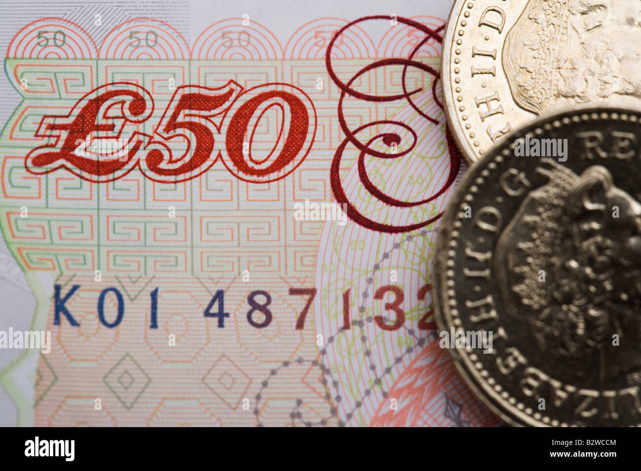 Fifty pound note and one pound coin - Stock Image