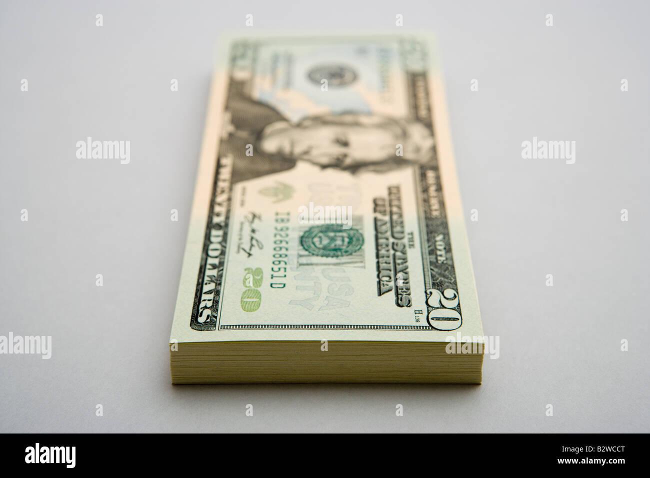 Stack of twenty dollar bills - Stock Image