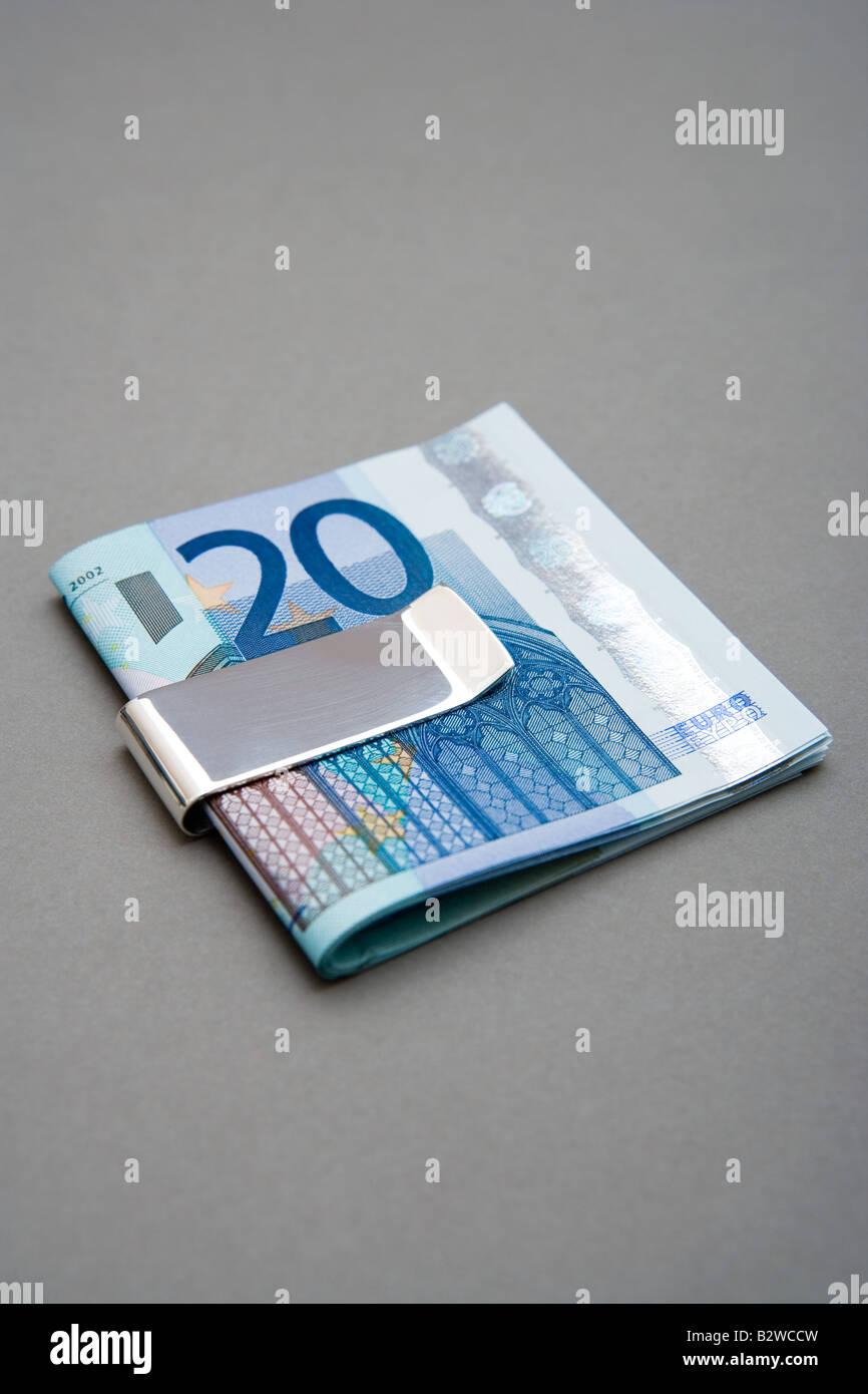 Twenty euro notes in money clip - Stock Image