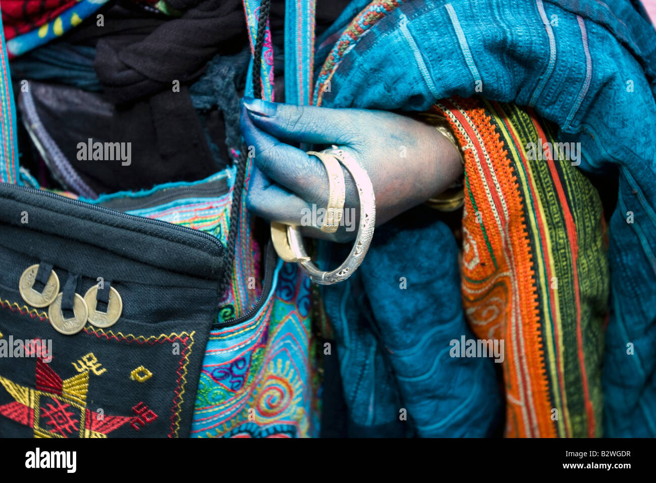 Black Hmong hilltribe woman with blue hands from dyed cloth Sapa Vietnam - Stock Image