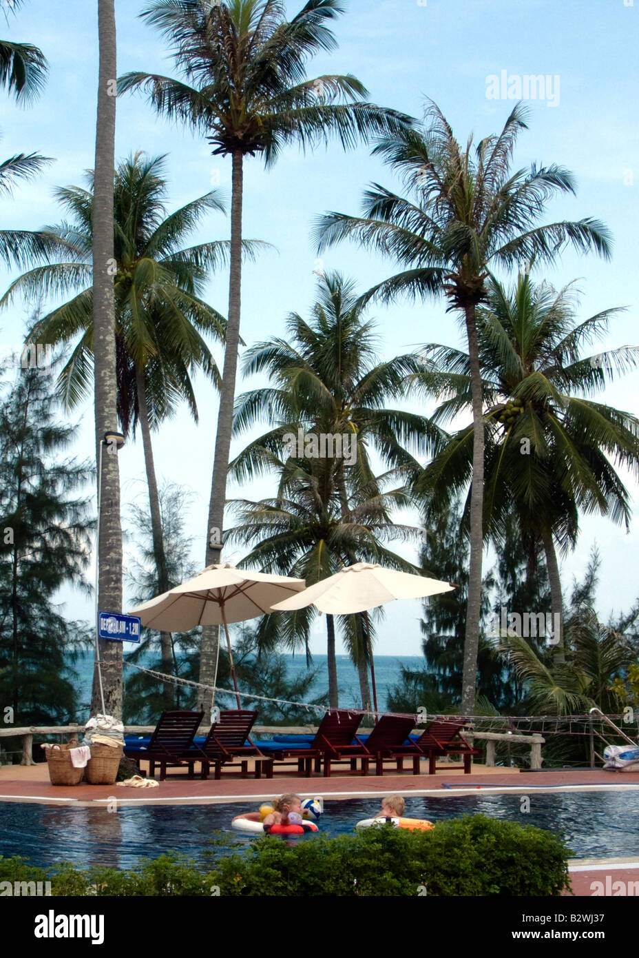 Resort pool surrounded by palm trees Phu Quoc Island Vietnam - Stock Image