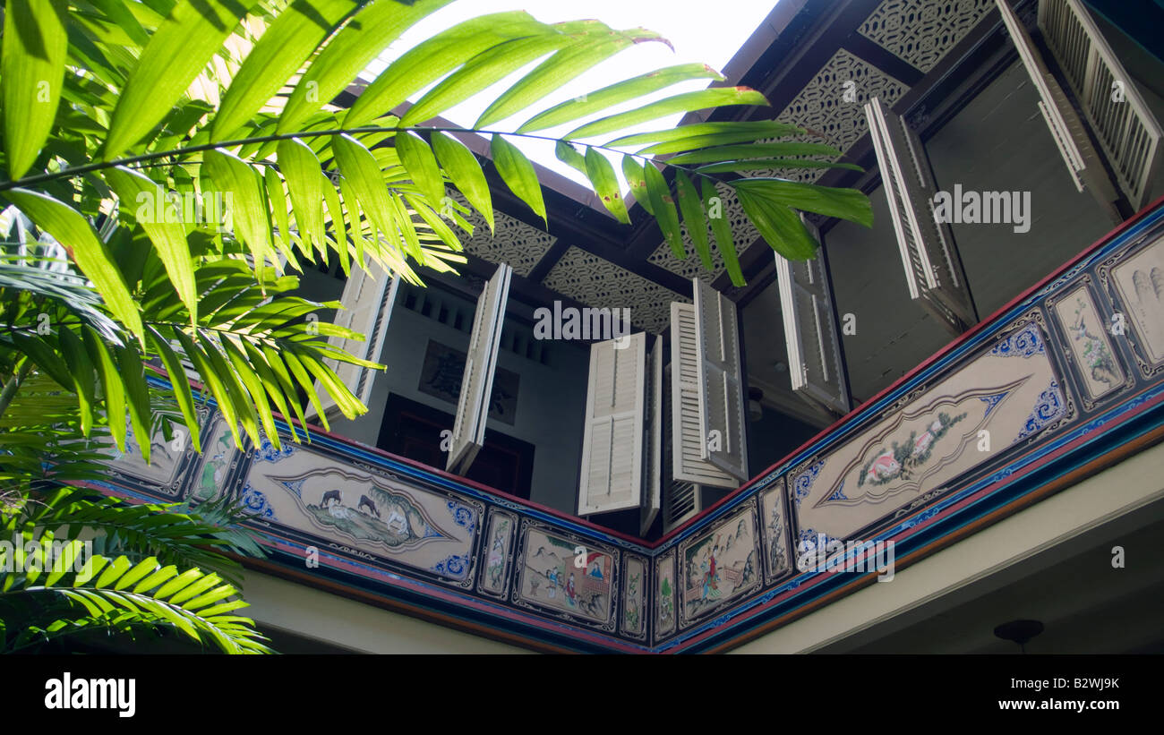 Balcony and shutters The Baba House historic boutique hotel Malacca Malaysia - Stock Image