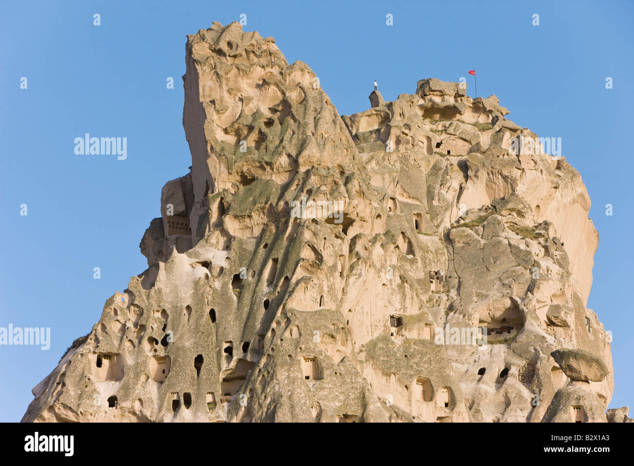 Old troglodytic cave dwellings and the rock Castle of Uchisar, Cappadocia, Anatolia, Turkey - Stock Image