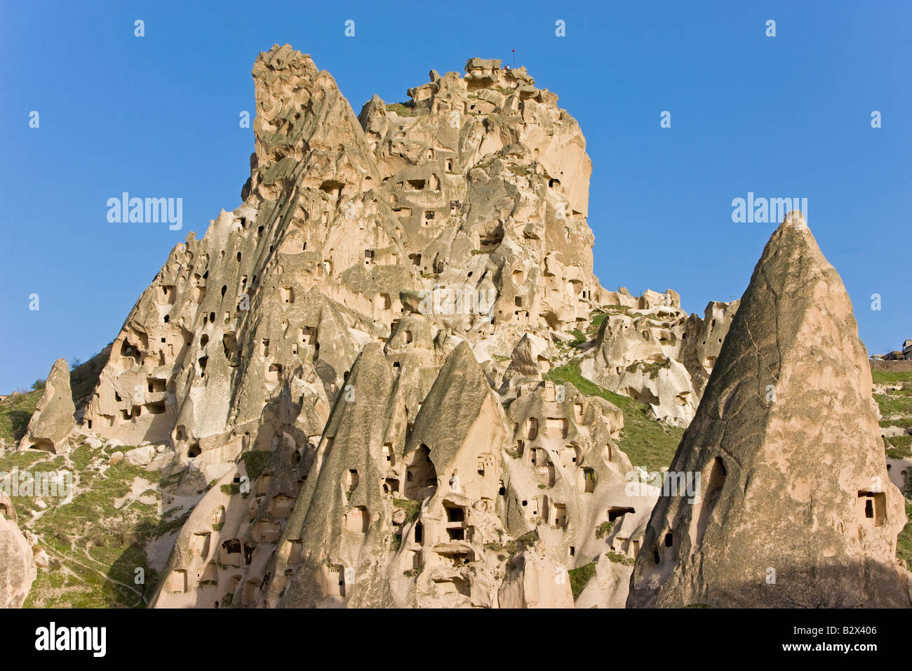 Old troglodytic cave dwellings and the rock Castle of Uchisar, Cappadocia, Anatolia, Turkey, Asia Minor, Eurasia - Stock Image