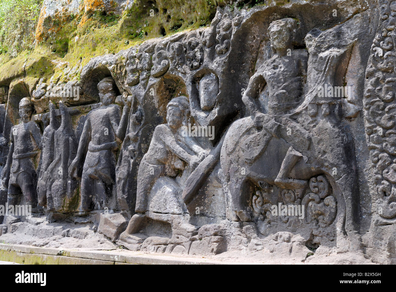 stone carving of Yeh Pulu BALI, INDONESIA, SOUTHEAST ASIA - Stock Image