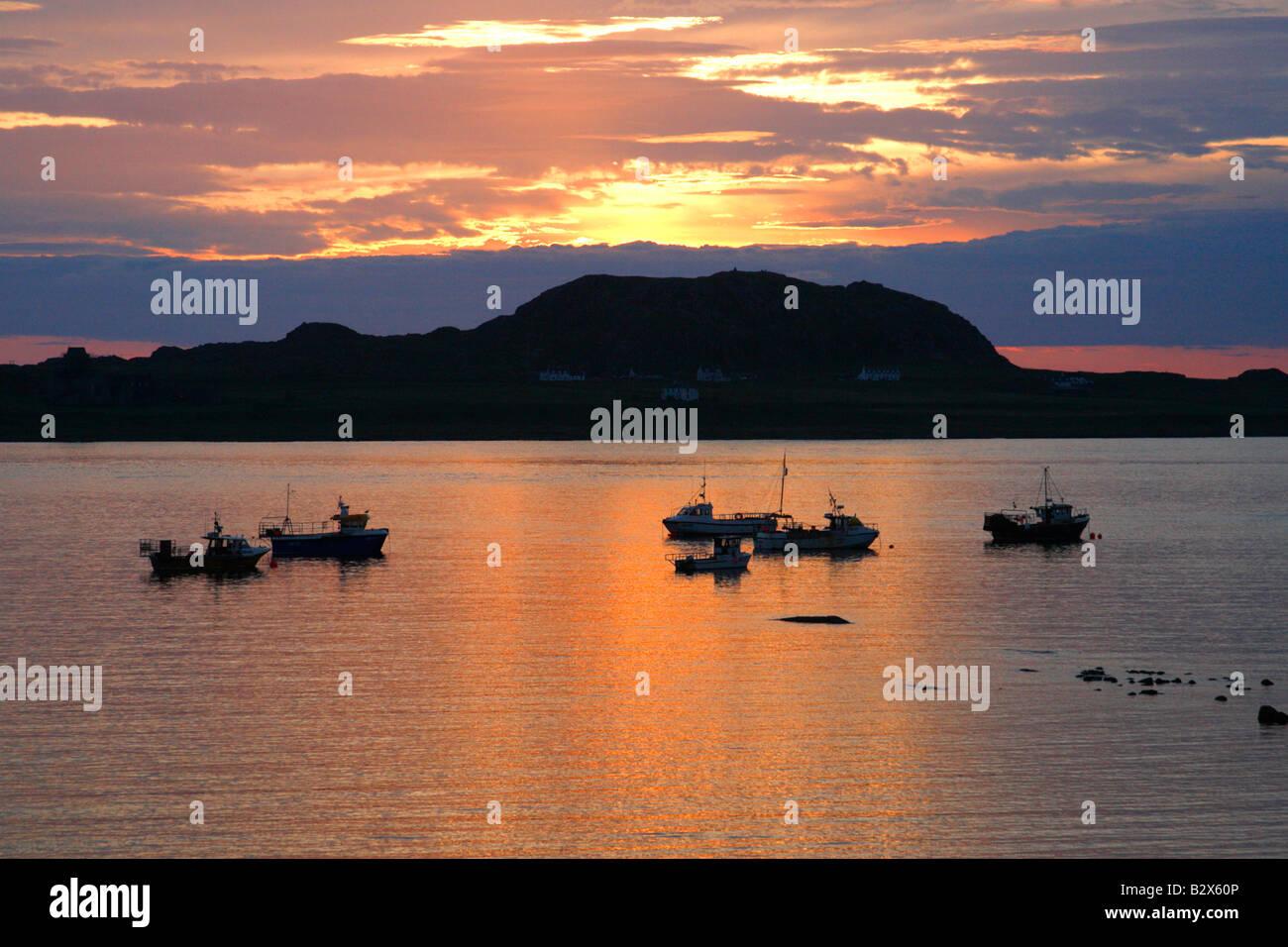 SUNSET OVER IONA TAKEN FROM ISLE OF MULL. WESTERN ISLES. SCOTLAND. UK - Stock Image