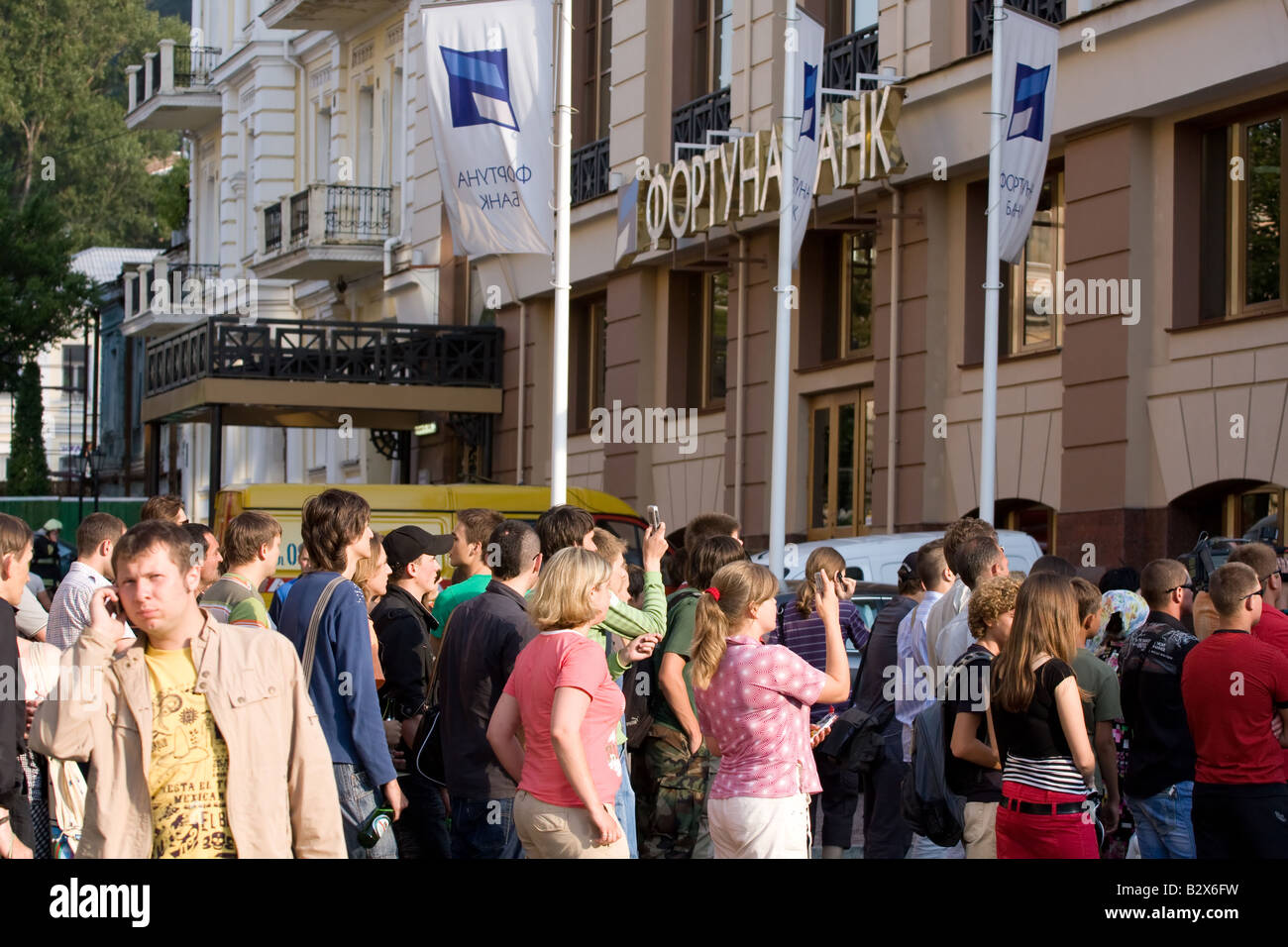 Onlookers on the street - Stock Image