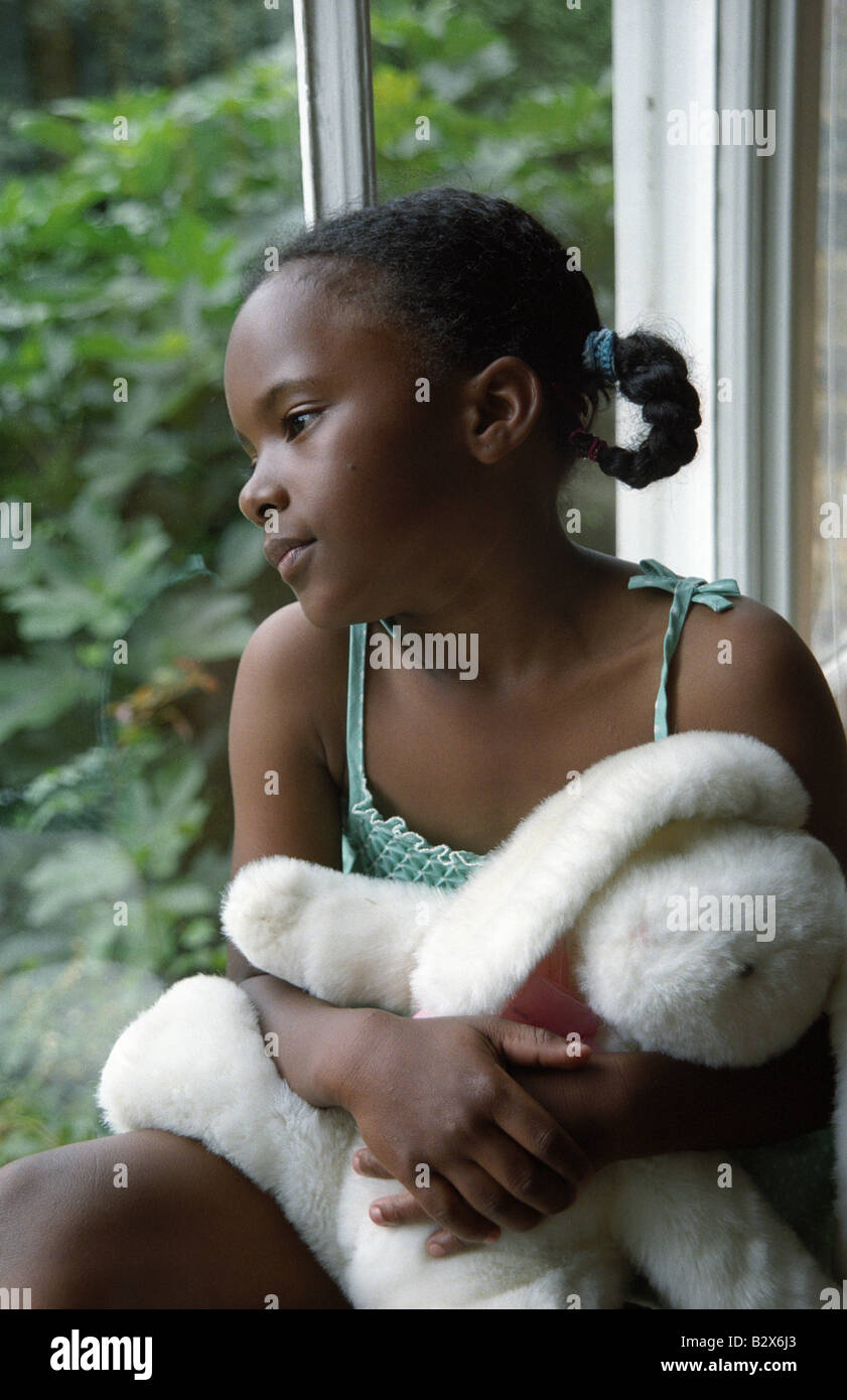 Little Black Girl Looking Out A Window Stock Photo Alamy