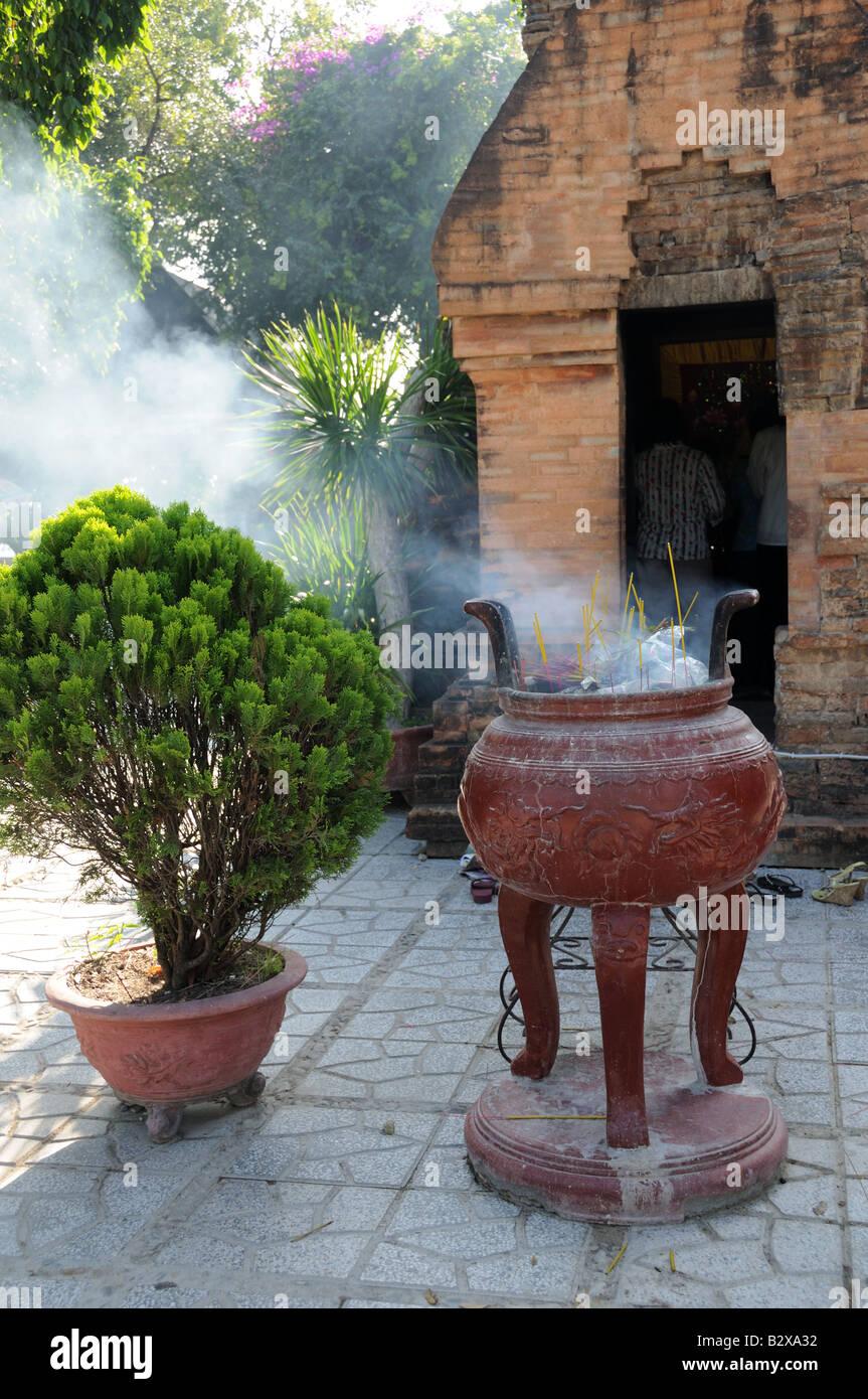 Incense burning at The Po Nagar Cham Towers Nha Trang Vietnam - Stock Image