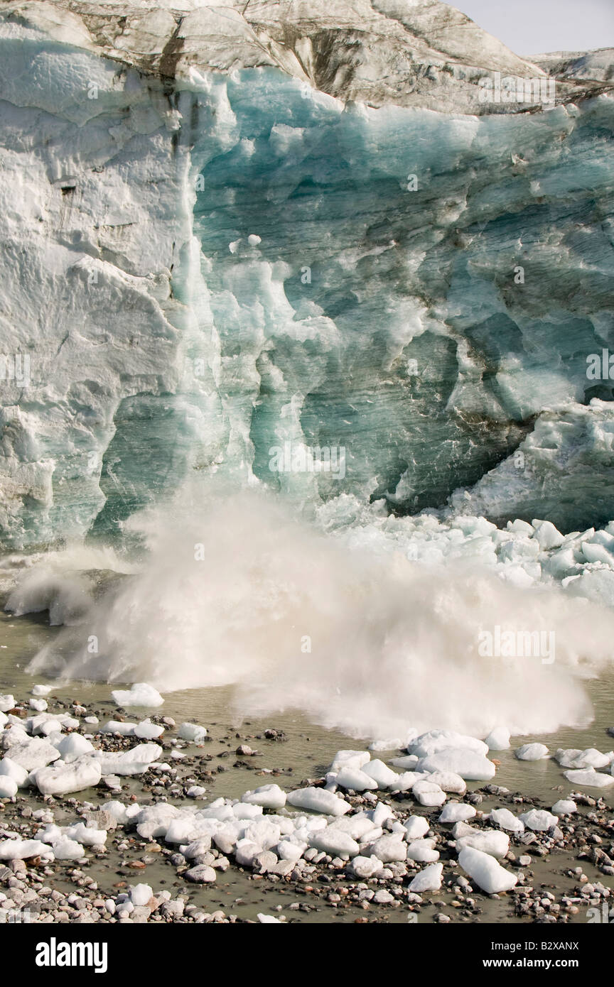Ice collapsing off the Russell Glacier near Kangerlussuaq on Greenland, which is receeding rapidly due to climate - Stock Image
