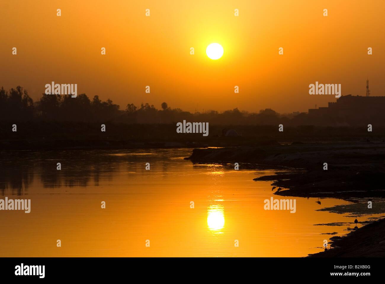 Sunset over Yamuna River, Agra, Uttar Pradesh, India, Subcontinent, Asia - Stock Image