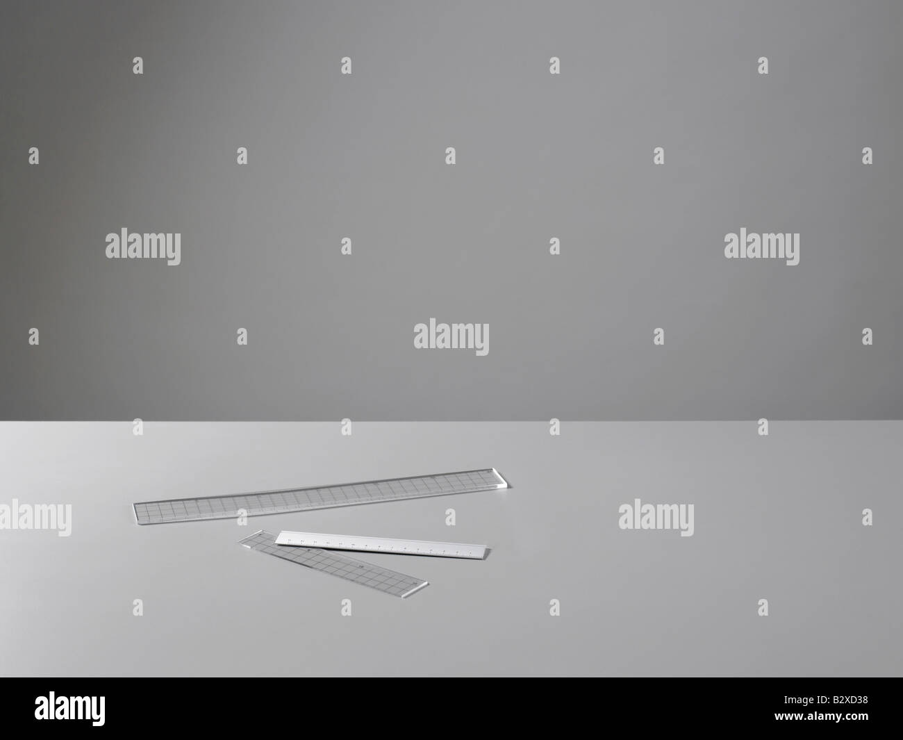 rulers on grey background - Stock Image