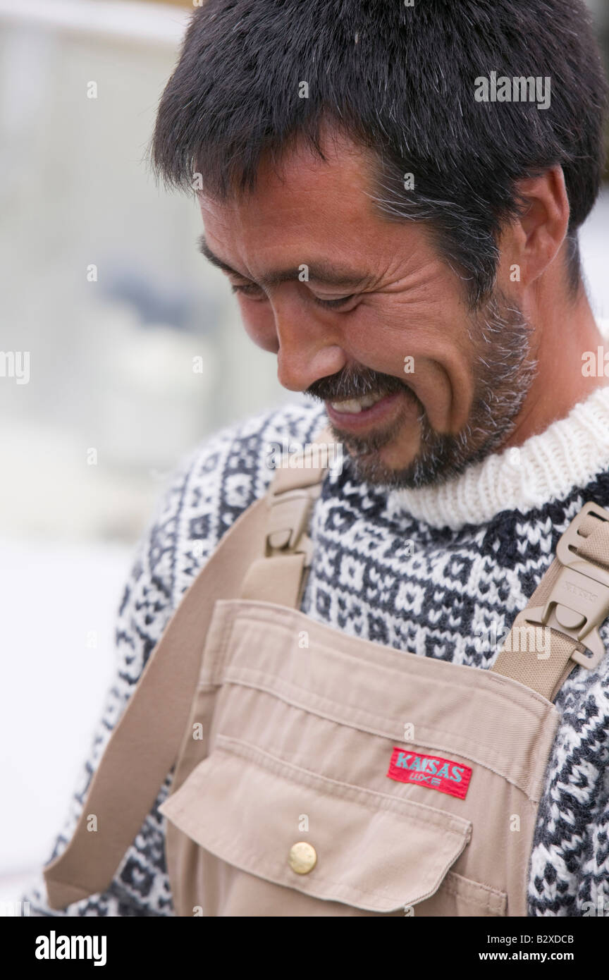 An Inuit fisherman in Ilulissat harbour on Greenland - Stock Image