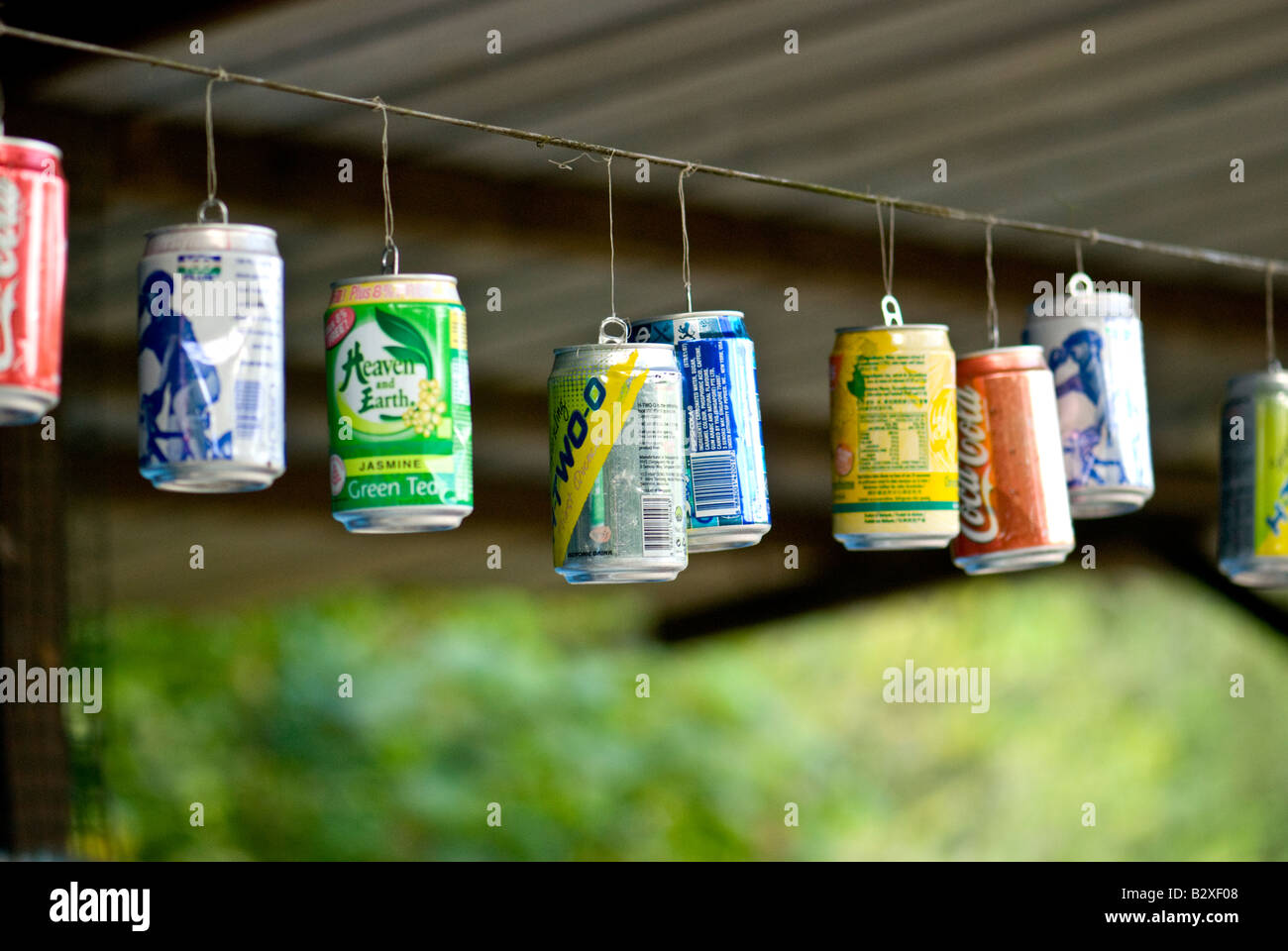 Soft drinks cans on string - Stock Image