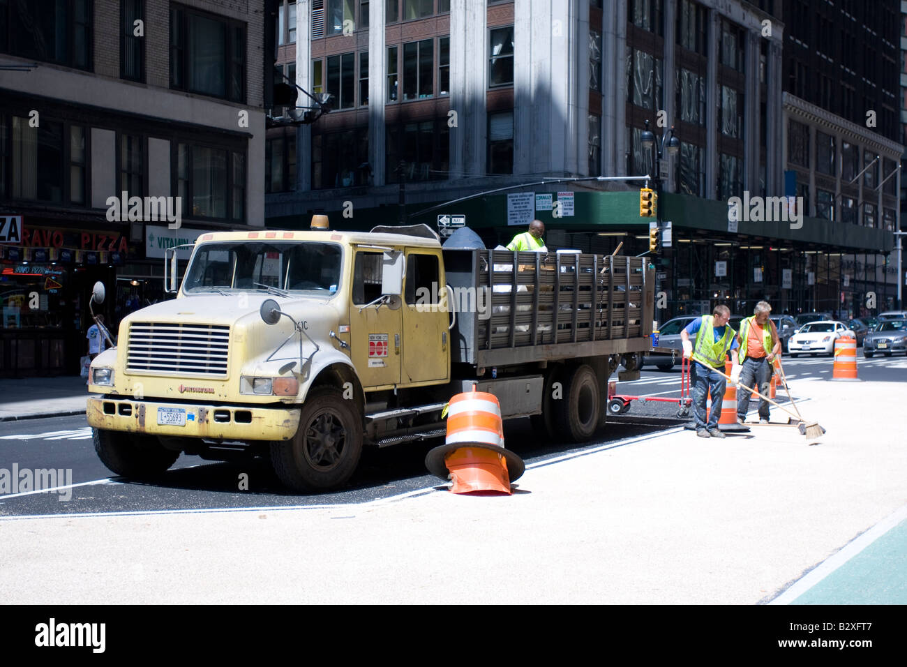 A New York City Department of transportation truck and road crew in Manhattan, New York. - Stock Image